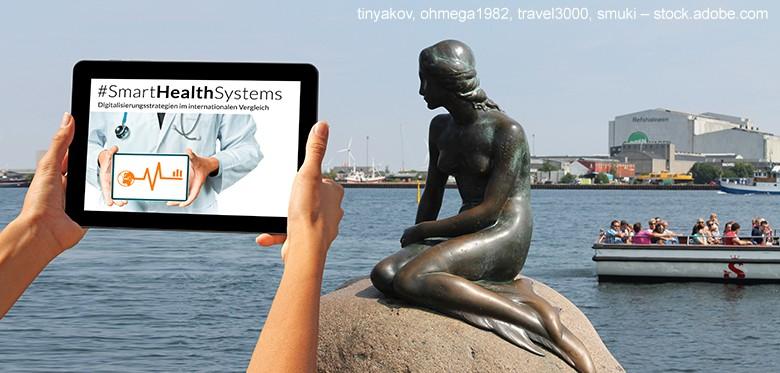 Meerjungfrau in Kopenhagen mit Tablet. Auf dem Display ist eine Anwendung zu sehen. Meerjungfrau in Kopenhagen hoch. Auf dem Display ist eine Anwendung zu sehen.